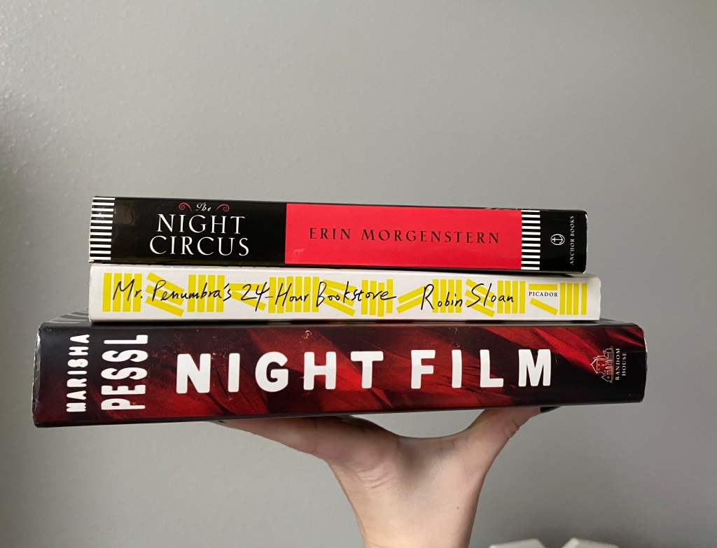 A stack of books I hope to read: Night Film by Marisha Pessl, Mr. Penumbra's 24-hour Book store by Robin Sloan and The Night Circus by Erin Morgenstern on top.